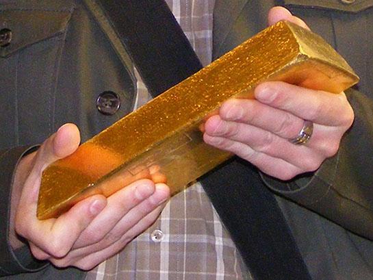 Man Holds Very Large Gold Bullion Bar