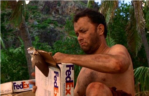 Tom Hanks in Cast Away opening a FedEx package